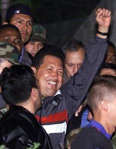enezuelan President Hugo Chavez (C) salutes on arrival at the Miraflores palace April 14, 2002. ©REUTERS