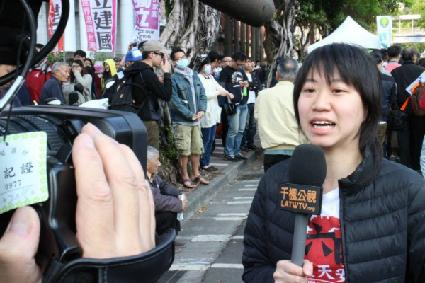 CWI comrade Sally Tang being interviewed on Taiwan TV