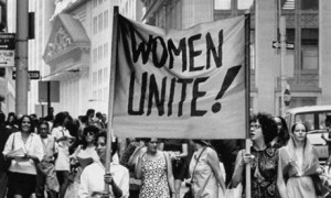 Signs saying Women Unite carried by women supporters during Women's Liberation demonstration on Fifth Avenue and on Wall Street. (Photo by John Olson//Time Life Pictures/Getty Images)
