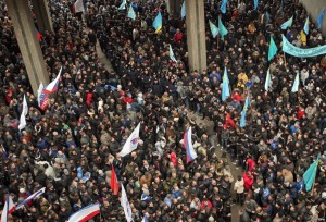 Pro-Russian activists and Crimean Tatar protesters and supporters of Euromaidan stand opposite each other near the Parliament building in Simferopol, Crimea, 26 February 2014
