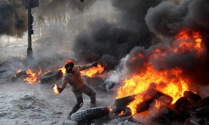A protester throw a Molotov cocktail towards riot police during a clash in central Kyiv, Ukraine, on Jan. 25, 2014. (AP Photo/Efrem Lukatsky)