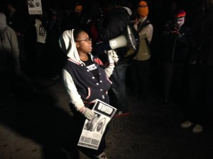 A young protester leads a chant on Canfield Road, the spot where Mike Brown was shot and killed. (Photo: Howard Koplowitz)