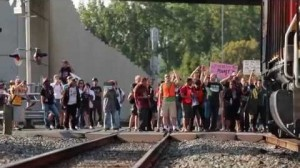 Protesters stop an oil train engine in Seattle on September 21st  (Screenshot of video by: DurianMD via reddit.com)