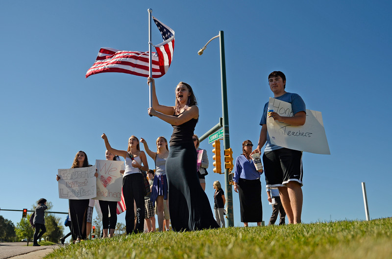 """LITTLETON, CO - SEPTEMBER 24: Student walk-outs in Jefferson County continued for the third straight day after students from Chatfield High School and Dakota Ridge High School left classes in protest of school board decisions and proposals, September 24, 2014. Students for the two schools joined together, at the corner of Ken Caryl and Chatfield Blvd. in Littleton, to wave sings. (Photo by RJ Sangosti/The Denver Post)"