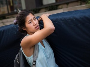 Emma Sulkowicz, a senior visual arts student at Columbia University, carries a mattress in protest of the university's lack of action after she reported being raped during her sophomore year. (Photo: AFP)