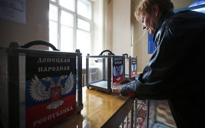 Member of a local electoral commission takes part in the preparations for the upcoming election in the rebel Republic of Donetsk. REUTERS/Maxim Zmeyev