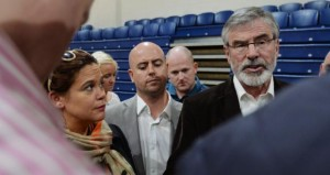 Sinn Féin leader Gerry Adams (right) tries to explain the defeat of candidate Cathal King (center), who lost to Paul Murphy  (Photo: Alan Betson/The Irish Times)