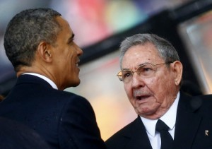 President Obama greets Cuba's President Raul Castro before giving a speech at the memorial service for late South African President Nelson Mandela in Johannesburg on Dec. 10, 2013 (Photo: Kai Pfaffenbach / Reuters)