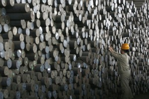A Wuhan Iron & Steel laborer marked steel bars in China's Hubei province in 2007. Wuhan helped petition for China's steel inquiry. (Photo: Reuters)
