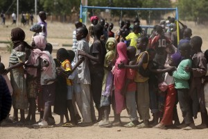 Children displaced by Boko Haram attacks line up at a camp of internal displaced people in Yola, Nigeria in November.  (Photo: AP)
