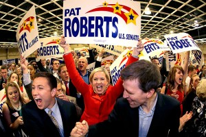 Supporters cheer before Kansas Sen. Pat Roberts makes his victory speech during a Republican watch party Tuesday, Nov. 4, 2014, in Topeka, Kan. (AP Photo/Charlie Riedel)