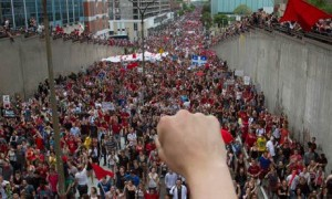 Thousands of demonstrators march to mark the 100th day of a student strike against tuition hikes in Montreal, Quebec, 22 May 2012. )