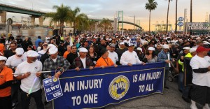 Workers gather in solidarity near the Vincent Thomas Bridge, before marching along the San Pedro waterfront on January 22, 2014. (Photo by Stephen Carr / Daily Breeze)