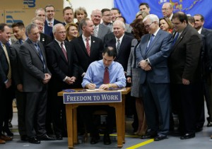 Gov. Scott Walker, a Republican, signed legislation in March that made Wisconsin the 25th state to prevent organized labor from requiring all workers to pay union dues or fees. (Photo: Mike De Sisti/Milwaukee Journal-Sentinel, via Associated Press)