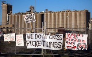 Signs are seen at the entrance of Port #5 on December 12, 2011 in Portland, Ore. Hundreds of Occupy Portland protesters effectively shut down two of the Port of Portland's busiest terminals on Monday, preventing about 200 longshore workers from going to work. (Photo: Natalie Behring/Getty Images)