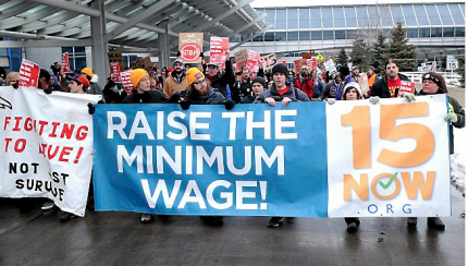 Airport workers rally for higher wages at Minneapolis-St. Paul International Airport on Friday, Dec. 5, 2014. (Pioneer Press: Jean Pieri)