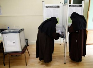 Carmelite Sisters prepare to cast their vote at a polling station in Malahide, Co. Dublin (Photo: Peter Morrison/AP)