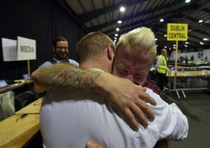 Gay couple who were married in Cape Town, South Africa embrace at the RDS count centre on May 23, 2015 in Dublin, Ireland. (Photo:  Charles McQuillan/Getty Images)