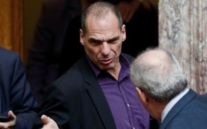 Greek Finance Minister Yanis Varoufakis speaks with an MP during a parliamentary session in Athens (Photo: Reuters/Alkis Konstantinidis)
