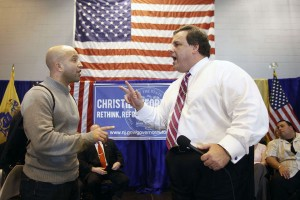 Keith Chaudruc, left, of Madison, debates Christie after he was invited to come up on stage with him. (Photo: Aristide Economopoulos/The Star-Ledger)