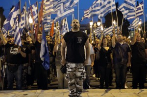 Members of Golden Dawn chant the national anthem in front of the Greek parliament on May 29, 2013, during a rally marking the anniversary of the fall of Constantinople to the Ottoman Empire in 1453. (Photo: AFP / Stringer)