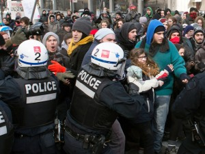 Police disperse demonstrators as students protest in Montreal against proposed austerity changes by the provincial government, Monday, March 23, 2015. (Photo: Ryan Remiorz / THE CANADIAN PRESS)