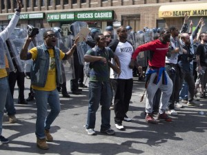 Demonstrators call for peace after a bottle is thrown at them on W. North Avenue in Baltimore, Maryland, April 28, 2015. (Photo: Jim Watson / AFP / Getty Images)