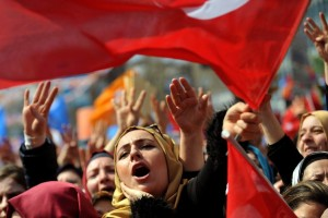 Supporters of Turkey's Justice and Development Party wave AKP flags as at a rally in Istanbul on March 29. (Photo: Agence France-Presse / Getty Images)