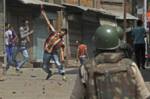 A Kashmiri Muslim protester throws stones and bricks at Indian police and paramilitary soldiers during a protest in Srinagar, India, Monday, Sept. 6, 2010.(Photo: AP Photo/Mukhtar Khan)