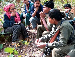 Roy with Gondi Maoists (Photo: outlookindia.org)