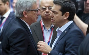 European Commission President Jean Claude Juncker (L) talks with Greek Prime Minister Alexis Tsipras during a European Union extraordinary summit seeking for a solution to the migrants crisis, in Brussels April 23, 2015.  (Photo: REUTERS / Yves Herman)