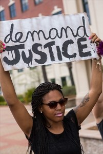 People participate in a rally to protest the death of Walter Scott, who was killed by police in a shooting, outside City Hall on April 8, 2015 in North Charleston, South Carolina (Photo: Richard Ellis / Getty Images)