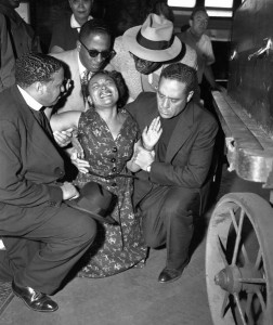 Mamie Till Mobley collapses when her son Emmett's body arrives at the old Illinois Central Railroad station after his torture and murder by racists in Mississippi. (Photo: Chicago Sun-Times Library)