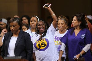 Workers in SEIU ULTCW, the United Long Term Care Workers' Union demanding the Los Angeles City Council vote to raise the minimum wage on Tuesday, May 19, 2015, in Los Angeles (AP Photo / Damian Dovarganes)