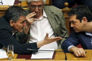 Greek Prime Minister Alexis Tsipras, right, listens to Finance Minister Euclid Tsakalotos as Justice Minister Nikos Paraskevopoulos, center, watches during a parliamentary session in Athens on July 23. (Photo: Reuters)