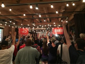 Hands go up as Kshama asks - Are you ready to knock on 80,000 doors?