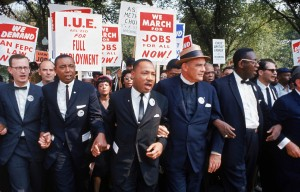Leaders of March on Washington for Jobs & Freedom marching with signs (R-L): Rabbi Joachim Prinz, [unidentified], Eugene Carson Blake, Martin Luther King, Floyd McKissick, Matthew Ahmann & John Lewis. (Photo: Robert W. Kelley / The LIFE Picture Collection / Getty Images)