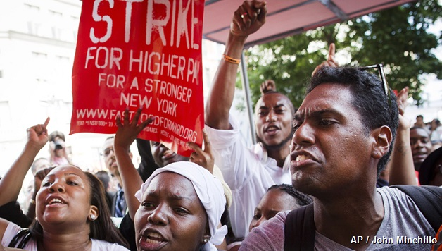 Demonstrators supporting fast food workers protest outside a McDonald's as they demand higher wages and the right to form a union without retaliation  Monday, July 29, 2013, in New York's Union Square. The national Fast Food Forward campaign is organizing the demonstrations. Strikes are planned in other cities this week. (AP Photo/John Minchillo)