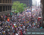 """May 1 2006 Rally in Chicago"" by User Flcelloguy on en.wikipedia - Photo taken by Andy Thayer, Chicago Indymedia Center. Image is released into public domain: ""CC. No rights reserved. This work is in the public domain."". Licensed under Public Domain via Commons - https://commons.wikimedia.org/wiki/File:May_1_2006_Rally_in_Chicago.jpg#/media/File:May_1_2006_Rally_in_Chicago.jpg"