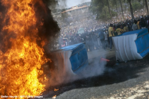 Militant protestors mill around a flaming barricade Photo: Stefan Heuris/AFP/Getty Images