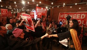 Kshama Sawant, candidate for district 3, Seattle City Council, celebrates an early majority at her election party at the Melrose Market Studios on Election Day, Tuesday November 3, 2015.  (Bettina Hansen / The Seattle Times)