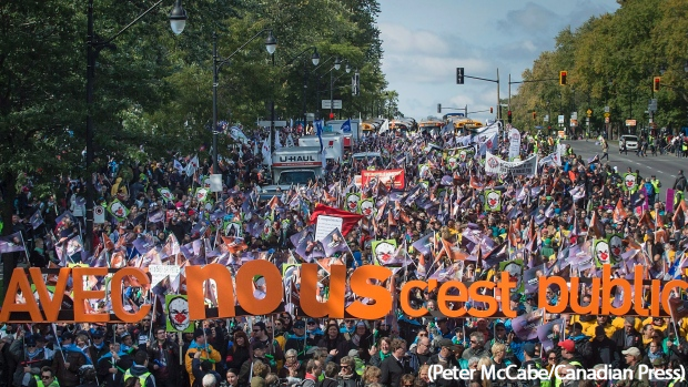 A Quebec coalition of public-sector unions marching in early October 2015. (Peter McCabe/Canadian Press)