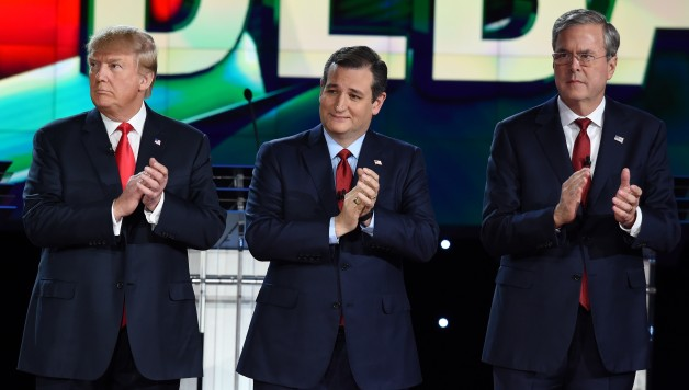 Republican presidential candidates (L-R) businessman Donald Trump, Texas Sen. Ted Cruz, and  former Gov. Florida Jeb Bush clap before the start of the Republican Presidential Debate, hosted by CNN, at The Venetian Las Vegas on December 15, 2015 in Las Vegas, Nevada.  AFP PHOTO / ROBYN BECK / AFP / ROBYN BECK        (Photo credit should read ROBYN BECK/AFP/Getty Images)