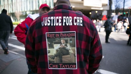 A friend of Che Taylor stands near the demonstration in front of Seattle Police HQ. Credit: Alex Garland/The Stranger