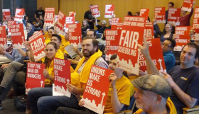 REI workers at Seattle City Hall explaining their demand for fair scheduling. Photo by Stephan Kimmerle