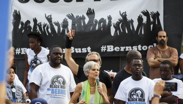 Presumptive 2016 Green Party presidential nominee Jill Stein speaks with 'Black Men for Bernie' supporters of former Democratic presidential candidate Bernie Sanders during the 2016 Democratic National Convention on July 27, 2016 in Philadelphia, Pennsylvania. / AFP / Patrick T. Fallon        (Photo credit should read PATRICK T. FALLON/AFP/Getty Images)