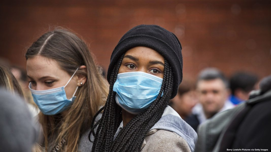 Young women wear face masks as protection against the coronavirus during Chinese New Year celebrations in London on January 26, 2020. Barry Lewis/In Pictures via Getty Images