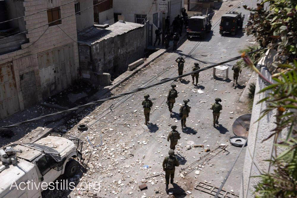 An Israeli military force during the funeral of Mohammed al-'Alami, 12, in the village of Beit Ummar, Photo: Oren Ziv / Activestills